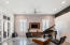 Living area - great bright light, stained concrete floors.