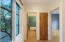 Full bath straight ahead, hall closet in middle & 3rd bedroom/office is to right.