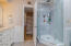 This raised Walk-In Shower is phenomenal! The combination of tile and glass walls are stunning!