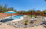 Take this Backyard in! The sparkling Pool with a shaded beach entry, alongside smartly laid artificial grass, for outside entertainment at it's finest!