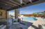 Covered back patio overlooks Catalina Mountains