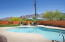 Large backyard with refreshing pool and beautiful landscaping