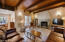 Beautiful beamed ceilings with cozy fireplace.
