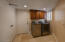 Laundry room leads to garage.