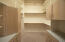 Large walk in closet in Master Suite #1 has extra storage