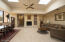 Large wood burning fireplace in living room/dining area with high ceilings