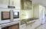 Amazing Kitchen with GE Cafe Retro Matte White Appliances.