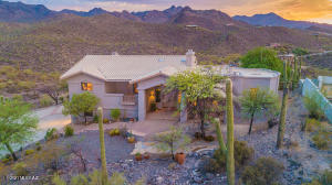Amazing custom home perched on a 2.3 acre hilltop lot.