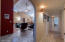 Hallway adjoins living space, with three generously sized bedrooms on one side.