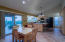 open kitchen with high ceilings of its own