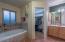 en-suite bath, off primary bedroom