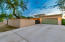 Generous concrete driveway for the 2-car garage is a recent addition to this home. Note 16-foot custom gate.