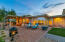 Back yard features a spacious covered patio and Santa Rita professional landscaping including extensive pavers, artificial turf, decorative rocks and low care plants.