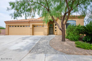 Front, 3 car garage, pavers, deco security front door, shade tree, drip irrigation, landscaped