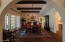 Wood Beamed Ceiling w/ Beautiful Chandelier & French Door to Patio/Pool Area