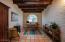 10' Plank & Beam Ceiling, Skylight, Arched window & Saltillo tile floors