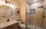 Updated shower w/tile surrounds & frameless glass shower door