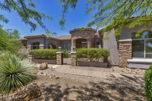 Gorgeous rock accents, gated courtyard, mature landscaping, 3-car garage
