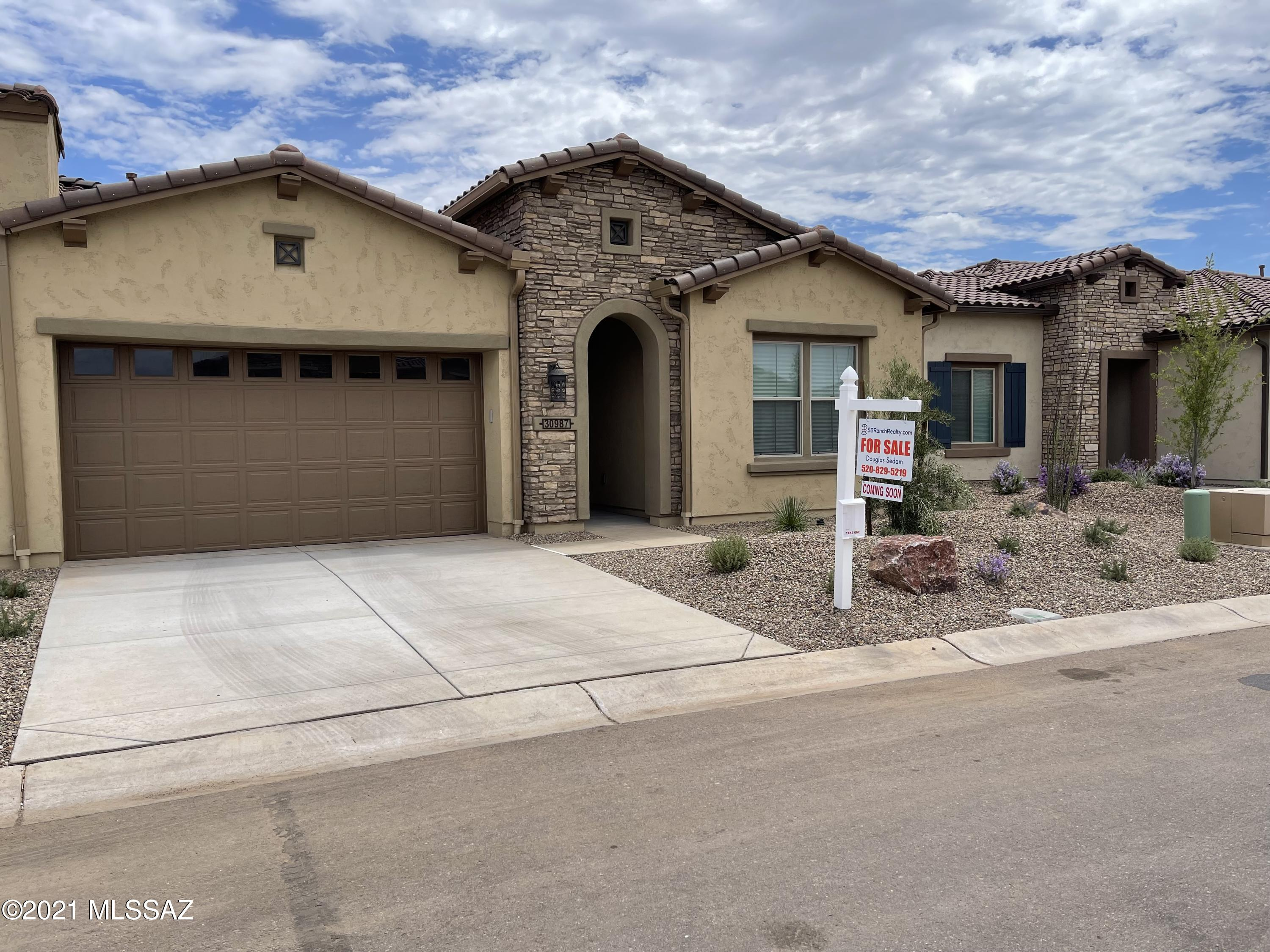BRAND NEW - NEVER LIVED IN VIVA - VILLA IN  SADDLEBROOKE RANCH. A gorgeous 1655 sq. ft.  2-bedroom and 2-bathroom townhome, w/Great Room, Spacious Den, Grand Kitchen Island, Walk-In Pantry, Media Alcove in Great Room, Master Bedroom w/En Suite Bathroom, Walk-in Closet, 42 X 60 Shower w/built in seat, Separate Laundry Room, 274 sq. ft. covered patio, Depp 2-Car Garage, 9' and 10'' ceilings, and Enclosed Private Courtyard that is approximately 214 sq. ft.   Seller spent ~$31,000 in upgrades and then installed ceiling fans, pendant lights  over Kitchen Island, Cabinet ''pulls'' on all cabinets, and Bathroom Accessories. Why wait 13-14 month's for a new Villa when you can be in this NEW home in less than 30-days!