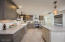 Updated kitchen features maple soft close cabinetry in slate and cream