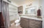 En-suite bath with executive height vanity and HUGE shower with grab bars