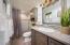 2nd en-suite bath with raised vanity. Glass tiled shower