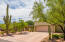 Large concrete driveway pad leads to the 2-car extended length garage.