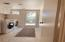 Laundry room with exit to backyard.