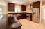 Granite countertops and view of kitchen.