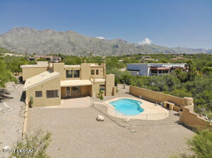 The 0.85 acre lot includes a spacious backyard and pool!