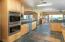 Wolf double oven & gas range, Wolf sub-zero fridge & GE Monogram wine cooler