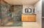 Frameless shower w/slate surrounds
