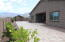 Beautiful Paver patio extends the width of the yard.