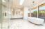 Magnifica Calacatta Porcelain floors and walls...Radiant Heated floors!