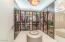 Dressing rooms filled with Italian Glass Enclosed Closets by Rimadesio