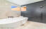 Casita Bath...Free standing tub & black textured tile wall bring the Spa Feel to a reality!
