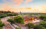 Elevated lot provides uncommon privacy and views.