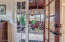 Master bedroom French door leading to greenhouse!