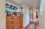 Hallway down to bedrooms hosts a built in cabinet/ linen dresser