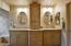 DOUBLE VANITIES IN THE BEAUTIFULLY REMODELED BATHROOM.