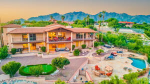 PERFECTION ... APPROX 6,000SQFT ON ALMOST AN ACRE WITH STELLAR MOUNTAIN, SUNRISE AND CITY NIGHT VIEWS. POOL, SPA AND PUTTING GREEN HELP CREATE THE ULTIMATE OUTDOOR ENTERTAINMENT SPACE.