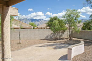 This picture from the covered patio shows some of the nice mountain peak views available from the yard.