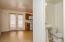powder room in hallway leading to kitchen