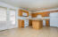 Huge Kitchen with Island, oak kitchen cabinetry and corian counter tops