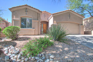 Gorgeous 4 bedroom, 2 full bath home situated on private lot inside gated La Paloma