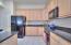 Pantry closet next to refrigerator