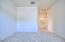 Primary bedroom is truly a suite! with ample space, high ceilings, walk in closet and huge bathroom