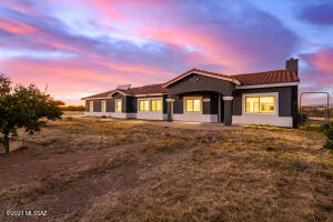 ENJOY GORGEOUS SUNSETS AND PRIVACY IN THIS SPACIOUS HOME ON MORE THAN 1 ACRE.