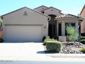Single story home with easy care landscaping