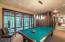 Billiard room has access to exterior custom hot tub and adjacent family room